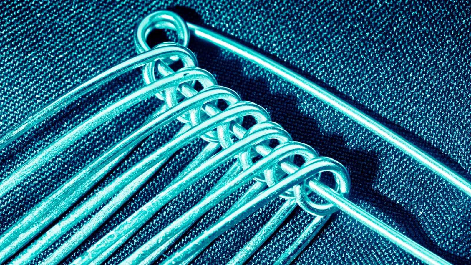 Close up of safety pins with blue filter