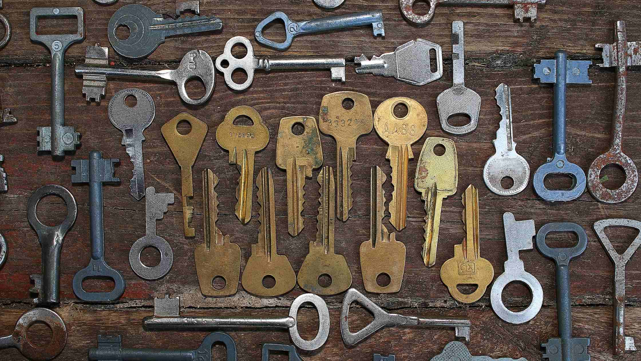 API security concept; keys of varying shapes and sizes on a wooden board