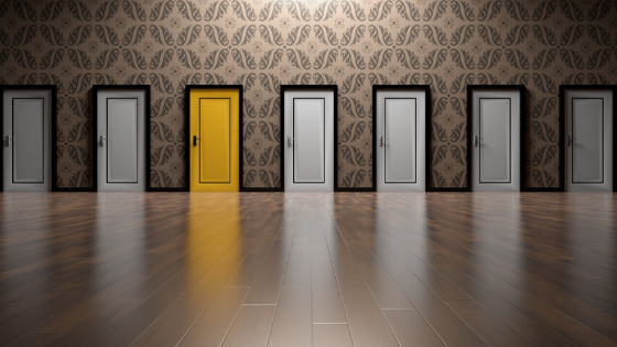 Choice concept; room with one yellow door in a row of white doors