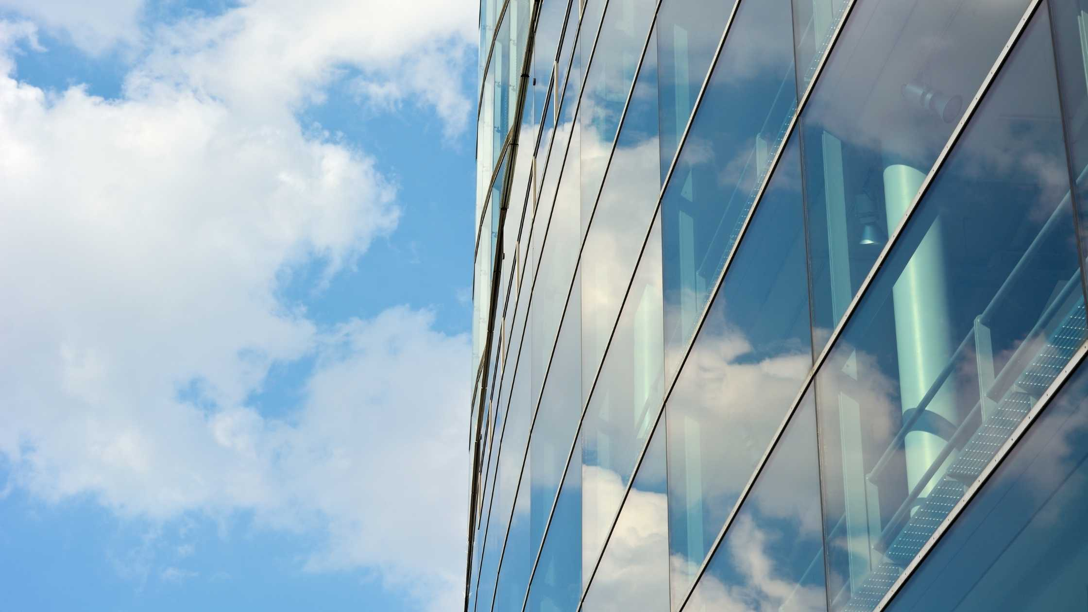 Contemporary architecture against cloudy blue sky