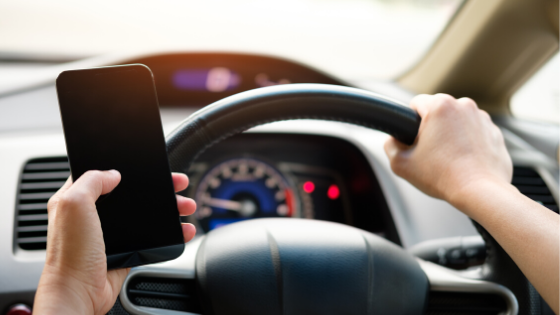 Mobility as a Service concept; close up of driver using mobile phone