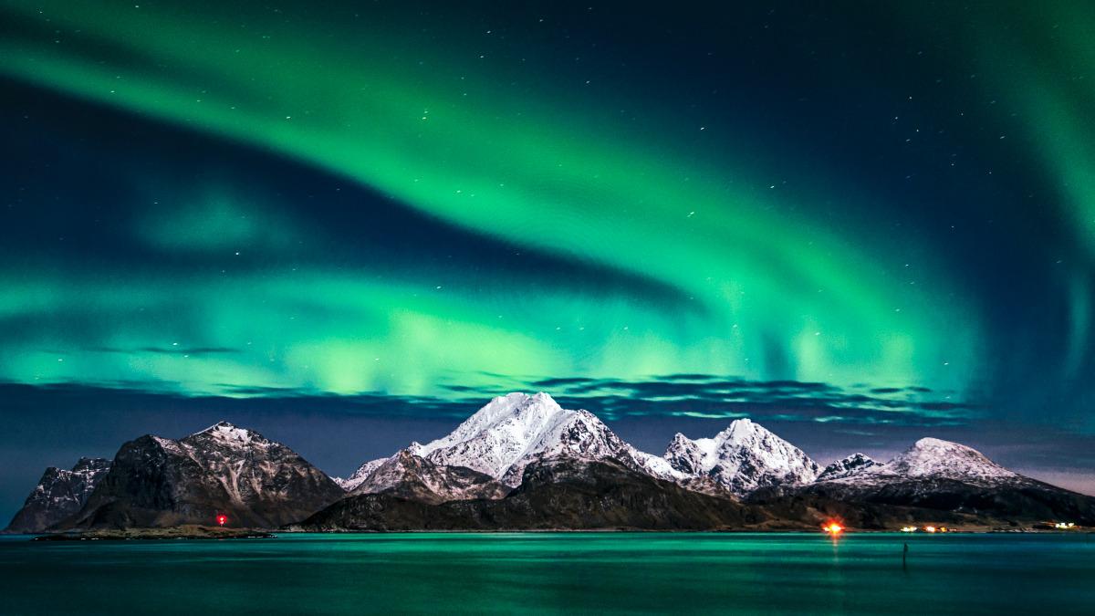 Aurora Borealis over a mountain and water