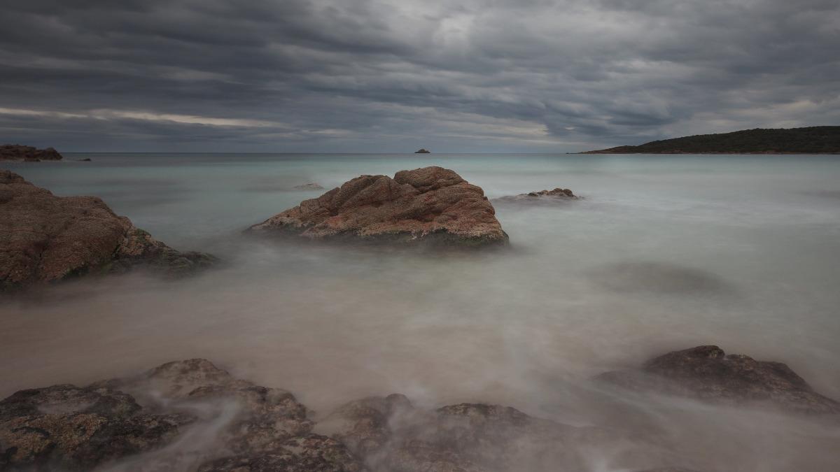 vapor above the sea and cloudy sky