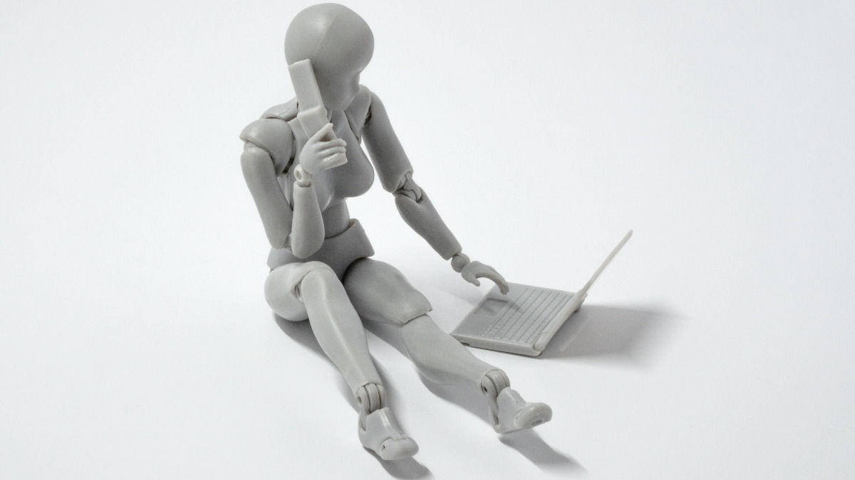 A woman robot using a computer to pose as a human being.