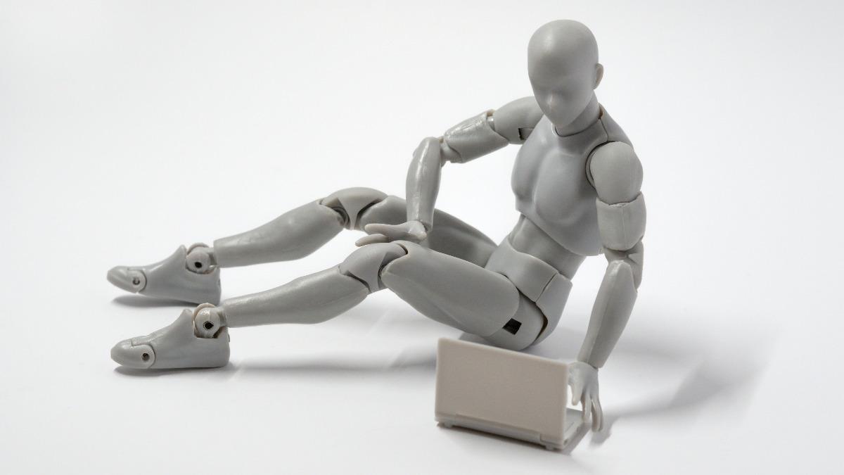 A robot using a computer like an human.